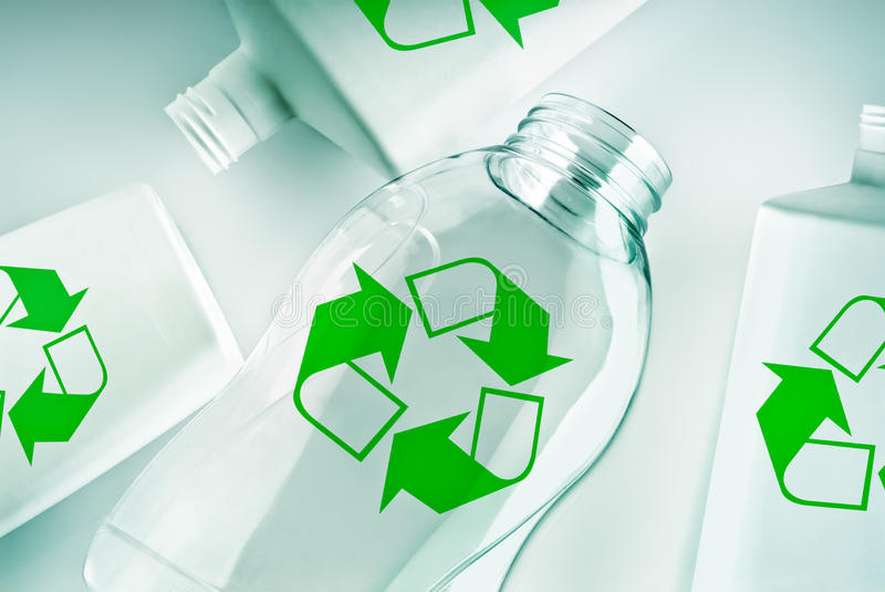 Plastic containers with recycle symbol stock images