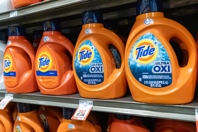 Plastic containers of Tide brand liquid laundry detergent. In a supermarket aisle royalty free stock image