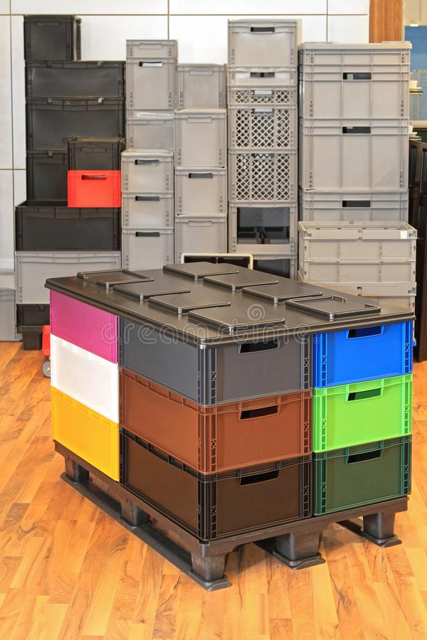 Plastic Crates at Pallet. Plastic Boxes and Crates for Shipping at Transport Pallet stock images