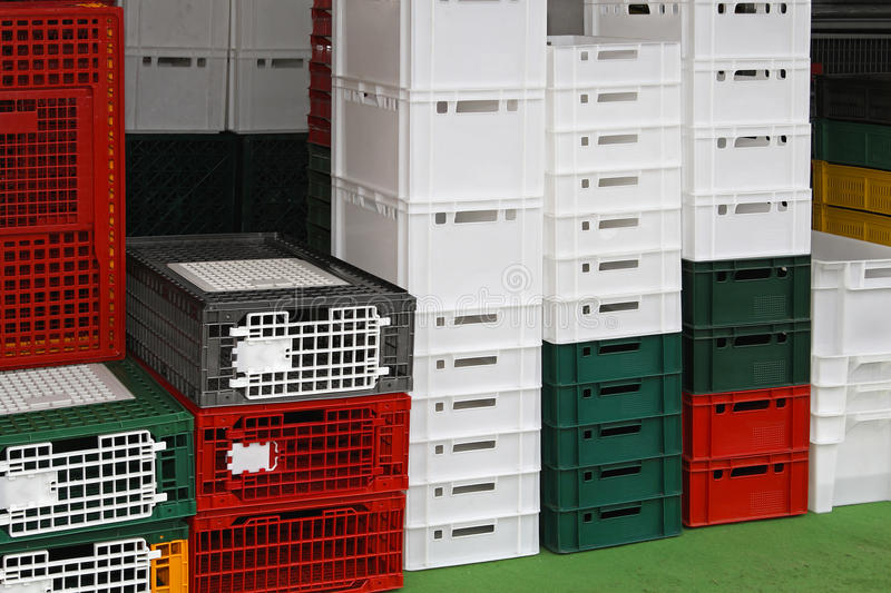 Poultry crates. Plastic crates and cages for poultry at farm stock images