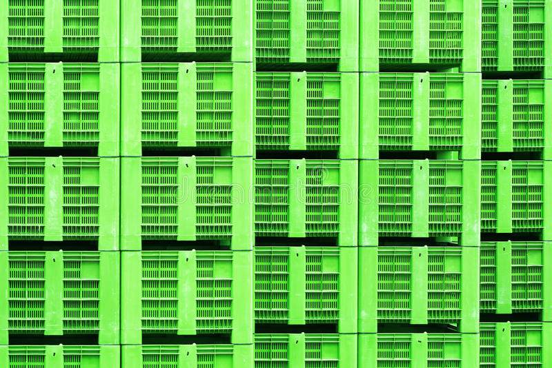 Plastic crates in green color, stacked royalty free stock images