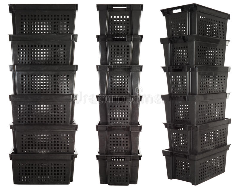Plastic crates | Isolated. Stacks of plastic warehouse containers isolated over white background stock photo
