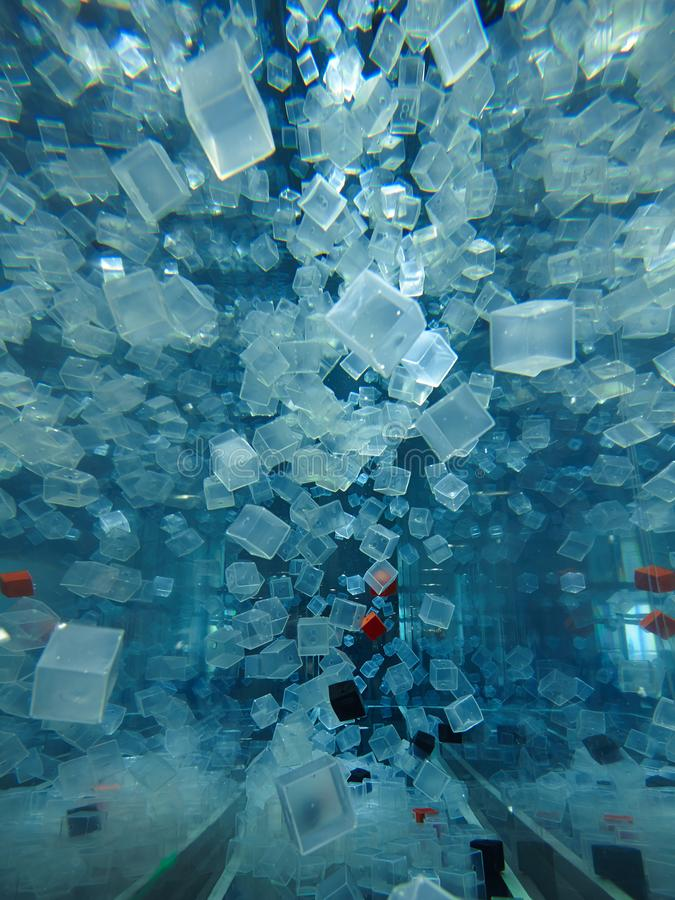 Plastic cubes in water. Many cubes making abstract waves in water