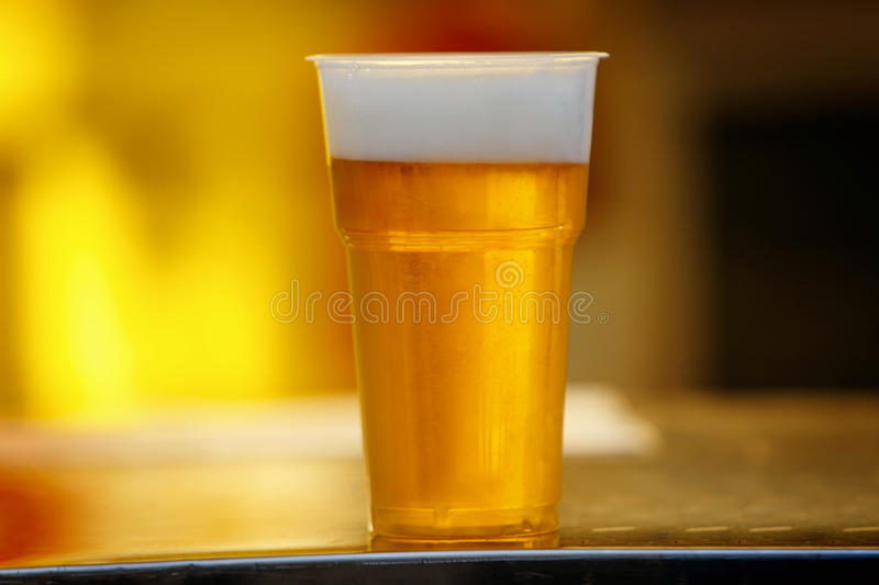 Plastic cup of beer, Disposable glass stock images