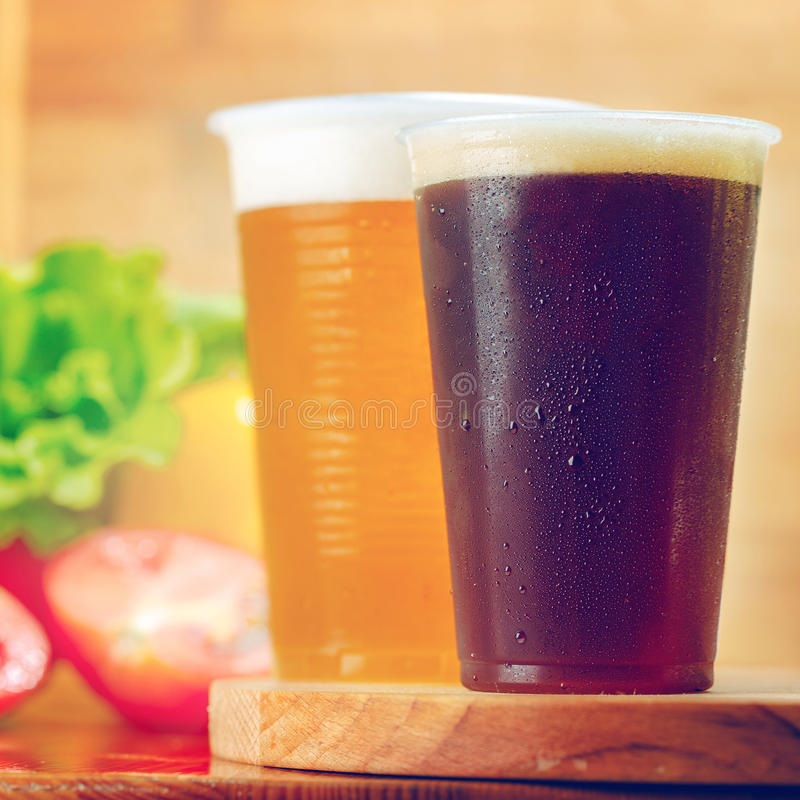 Plastic cups of beer stock photo
