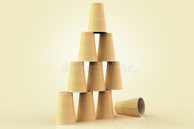 Plastic cups stacked in a pyramid with one fallen down representing the concept of failure at teamwork. royalty free illustration