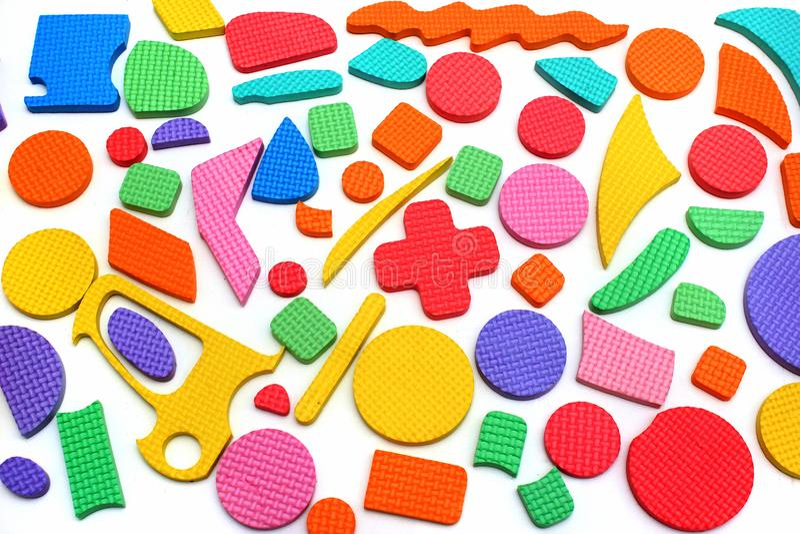 Plastic cutout children puzzle pieces royalty free stock images