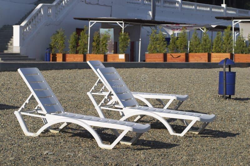 download plastic deckchairs stock photo image