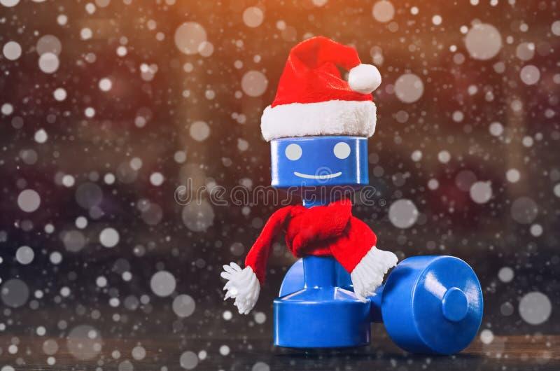 Plastic domoor met een rood GLB van Santa Claus in de gymnastiek, close-up tegen de achtergrond van sneeuwvlokken royalty-vrije stock afbeelding