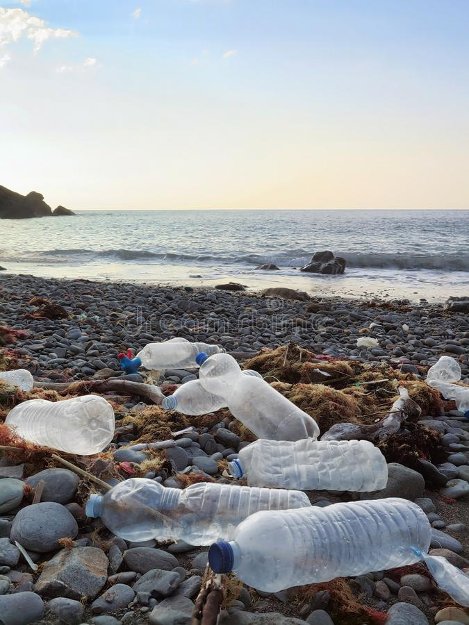 Plastic drinking bottles washed on the atlantic shoreline or beach polluting the environment in northern spain. Plastic bottles washed on the atlantic shoreline stock image