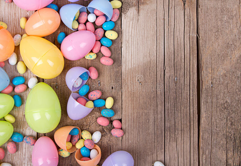 Download Plastic Easter Eggs And Candy Royalty Free Stock Photography
