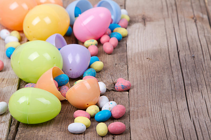 Download Plastic Easter Eggs And Candy Stock Photo