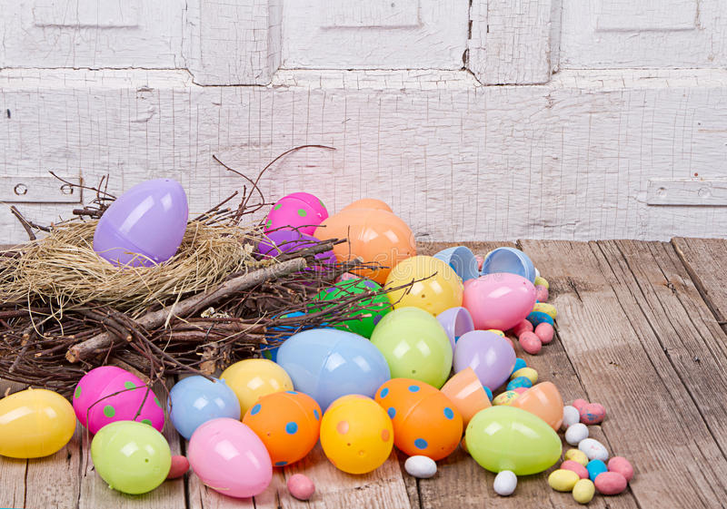 Download Plastic Easter Eggs And Candy Stock Photography