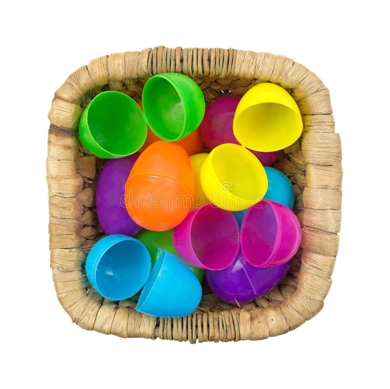 Download Plastic Easter Eggs In Wicker Basket Top View Stock Photo