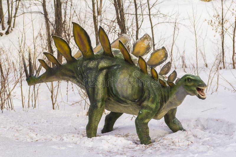 Plastic figure of a dinosaur in dinopark stock photo