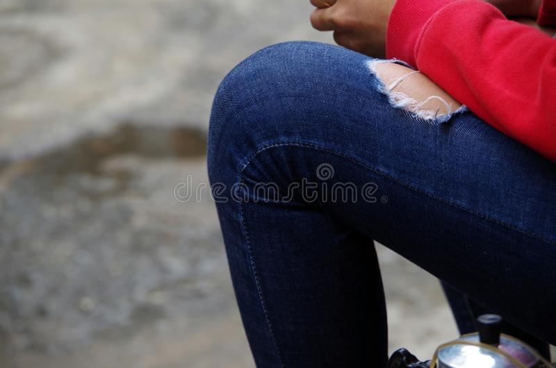 the torn jeans stock photography