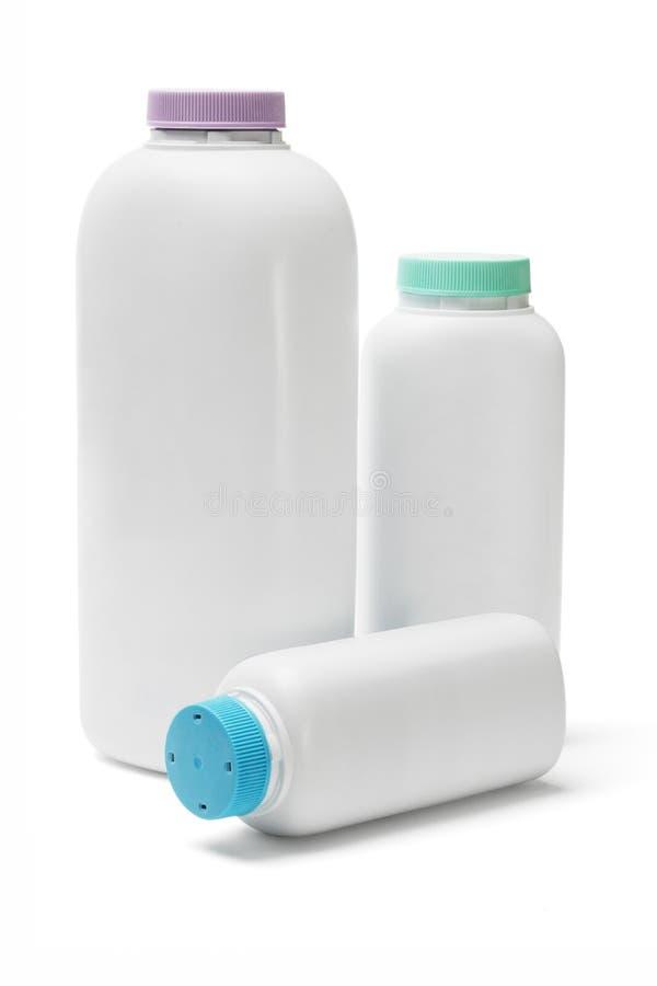 Plastic flessen talkpoeder stock foto