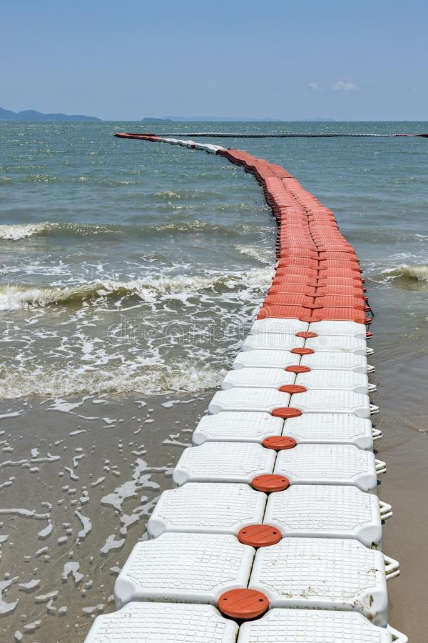 Plastic Floating Dock Plastic Pontoon Cubes in the sea in sunny day royalty free stock images