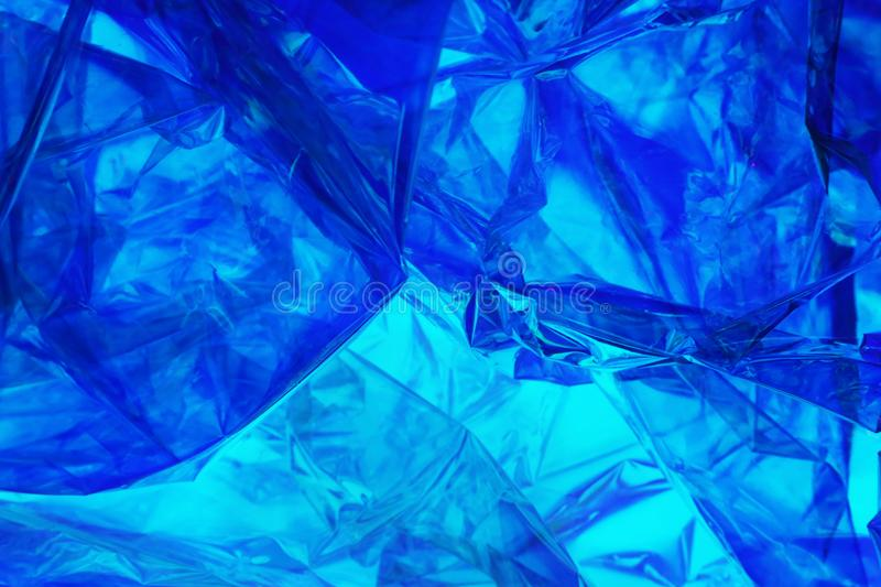 Plastic foil in Blue colored polarized light royalty free stock photography