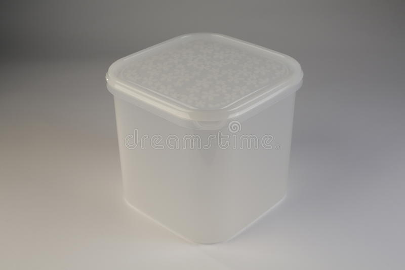 Plastic food box with colorful lid. On white background stock images