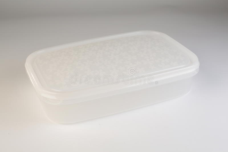 Plastic food box with colorful lid. On white background royalty free stock photography