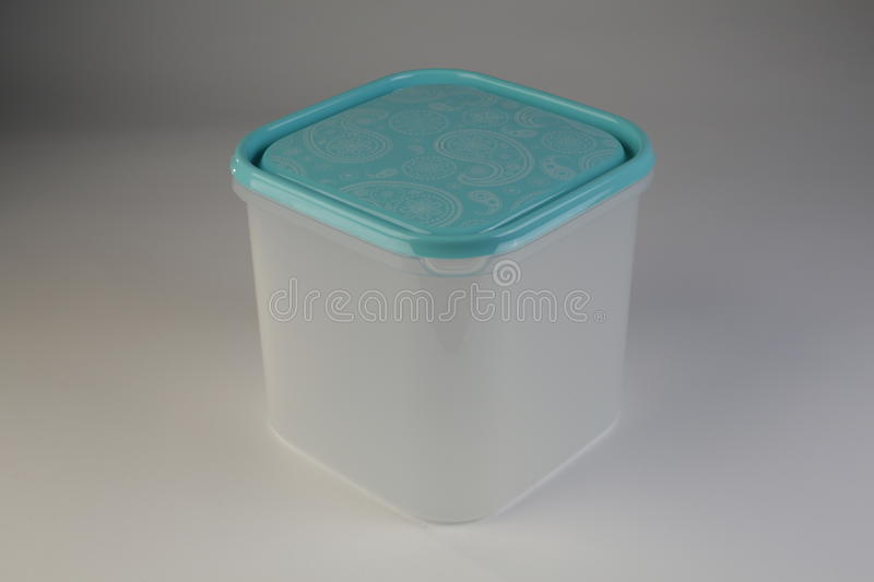 Plastic food box with colorful lid. On white background stock photos