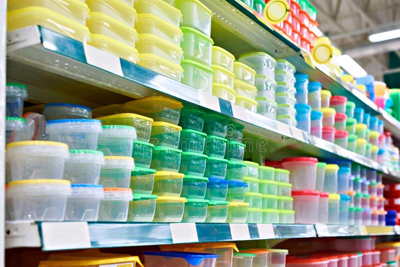 Plastic food boxes in store. Plastic food containers on the shelf in the store stock photos