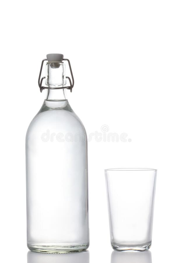 Plastic free concept:  glass water bottle and water glass isolated on white background with clipping path and copy space for your. Plastic free concept:  glass stock images