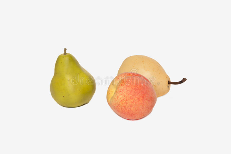 Plastic fruit on a background isolated royalty free stock images