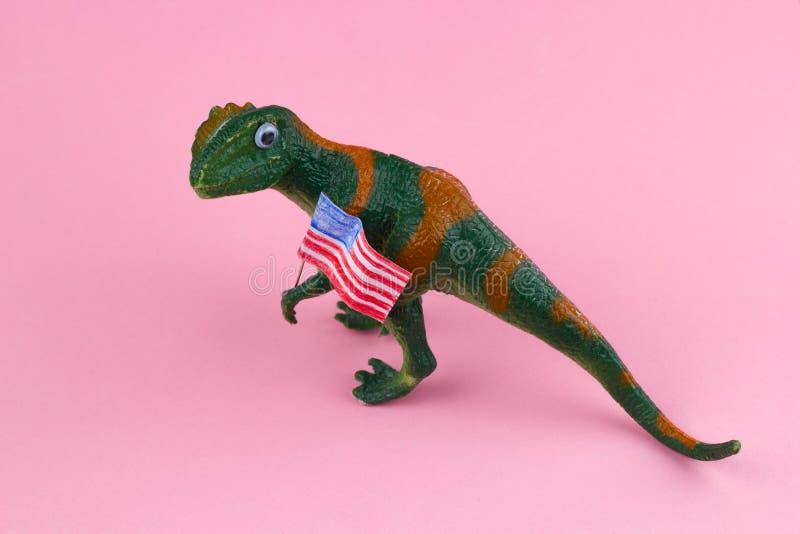 Plastic funny green dinosaur stock photos