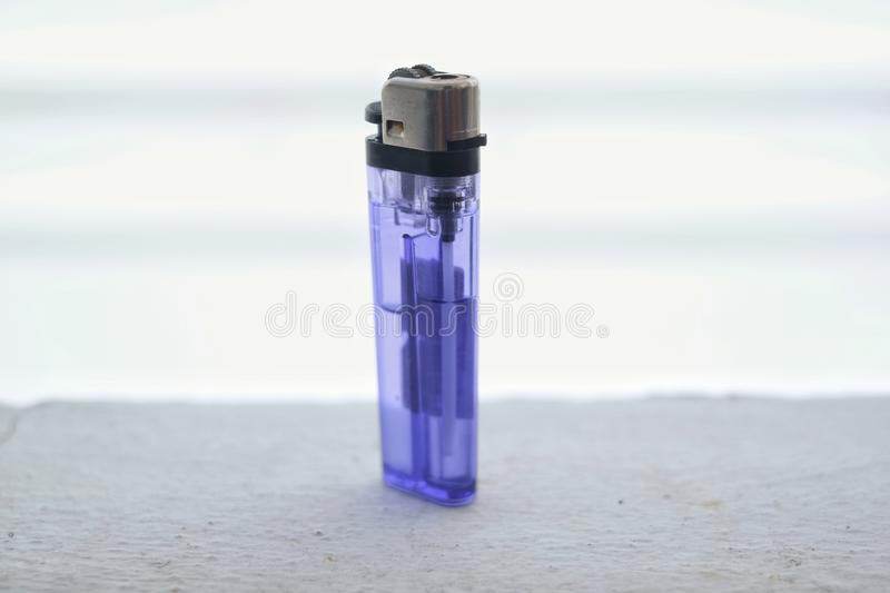 Plastic gas lighter for cigarette smoker. royalty free stock images