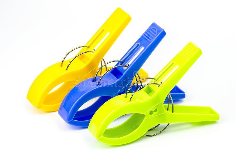 Plastic geïsoleerde Klemmen stock foto
