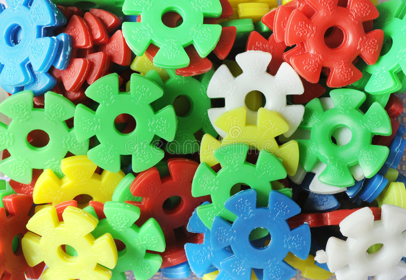 Plastic Gear Wheels Of Different Colors Stock Photos