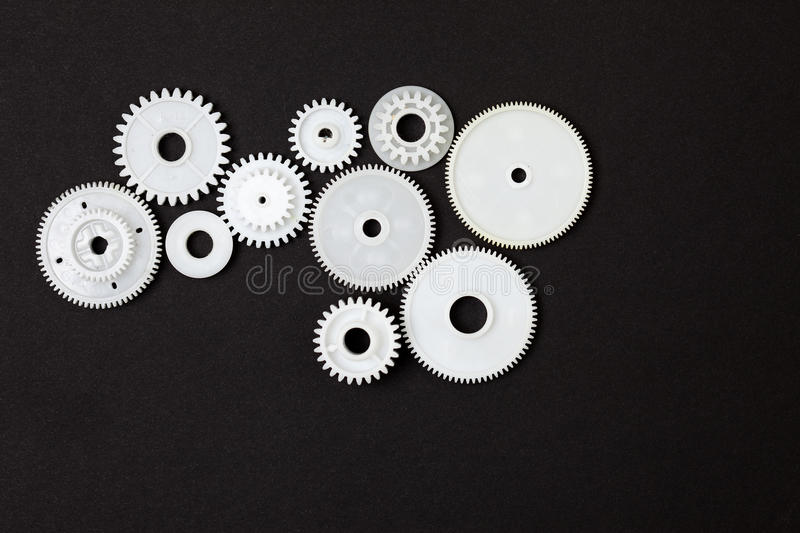 Plastic gearwheels. On a black background royalty free stock image