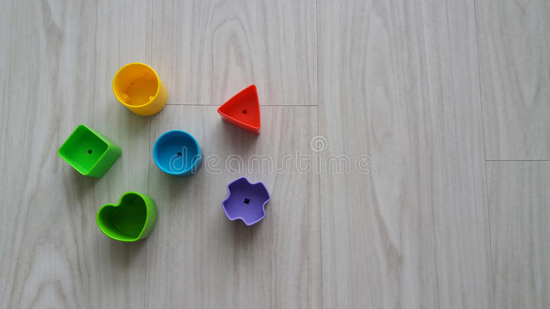 Plastic geometric pieces stock images