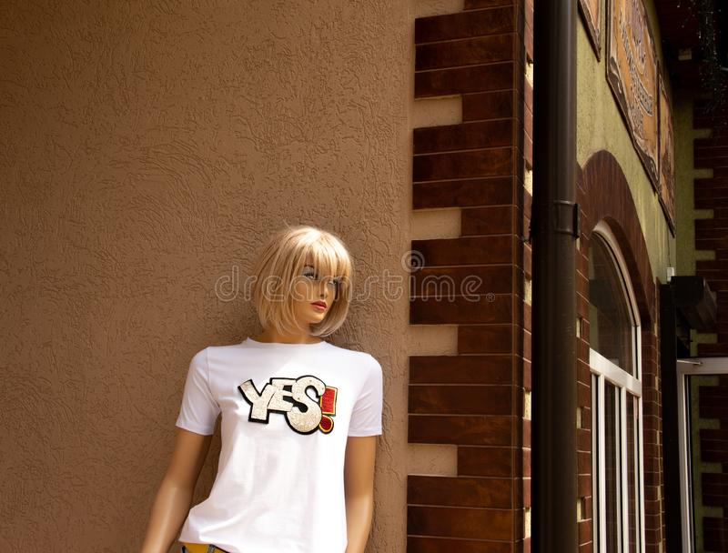 Plastic girl is waiting for her plastic friend on the street corner royalty free stock photos
