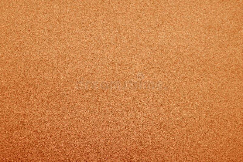 Plastic glittering texture in orange color stock photos