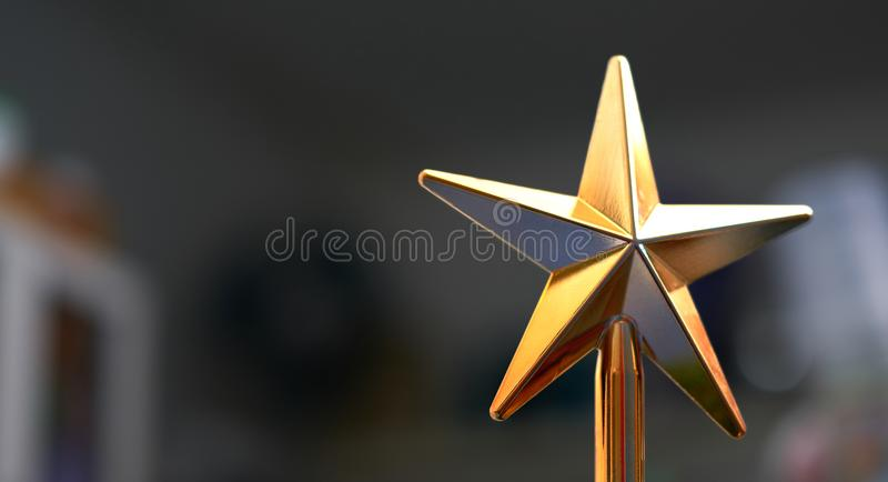 Plastic golden star for decoration interioe or cerebration such. As christmas stock photo