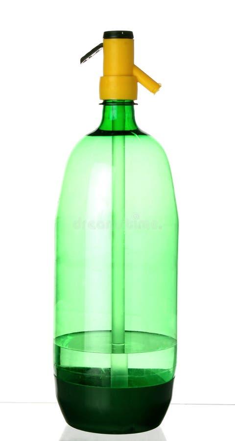 Plastic grön sodavattenhävert arkivfoto