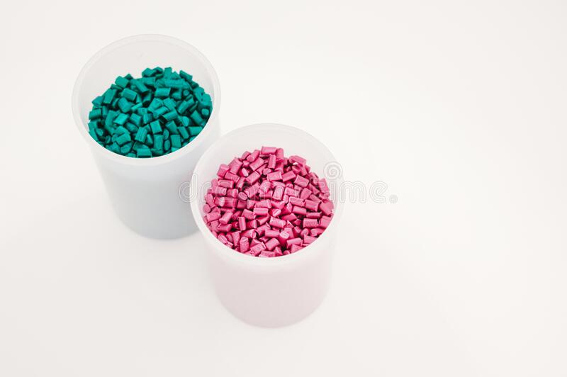 Plastic industry,Plastic Business,Plastic granules close up for holding,Colorful plastic granules with white background. Plastic granules close up for holding stock photos