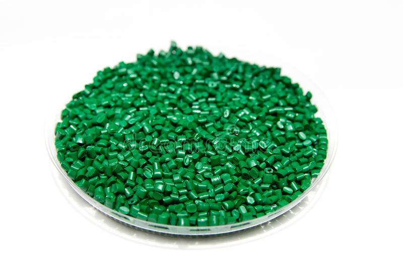 The plastic granules. Dye for polypropylene, polystyrene granules into a measuring container. The plastic granules. Dye for polypropylene, polystyrene granules stock images