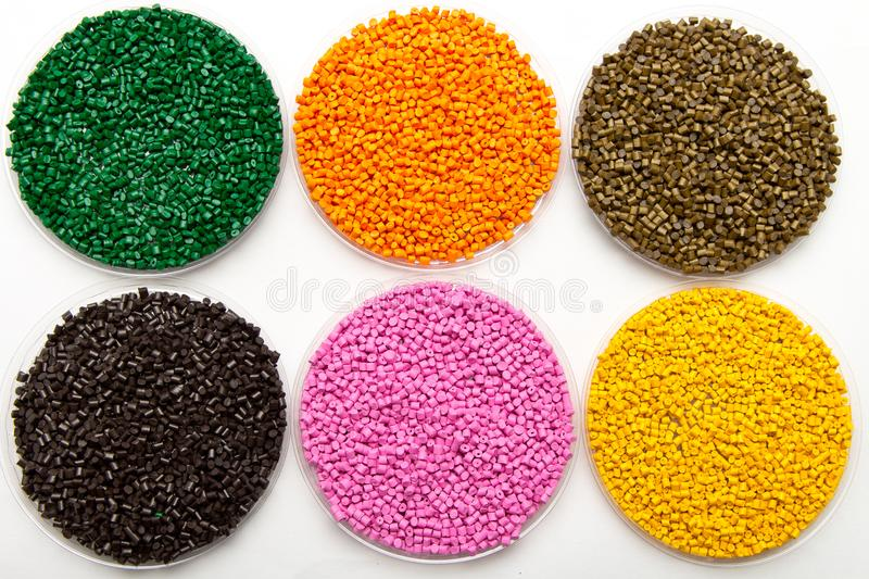 The plastic granules. Dye for polypropylene, polystyrene granules into a measuring container.  stock images