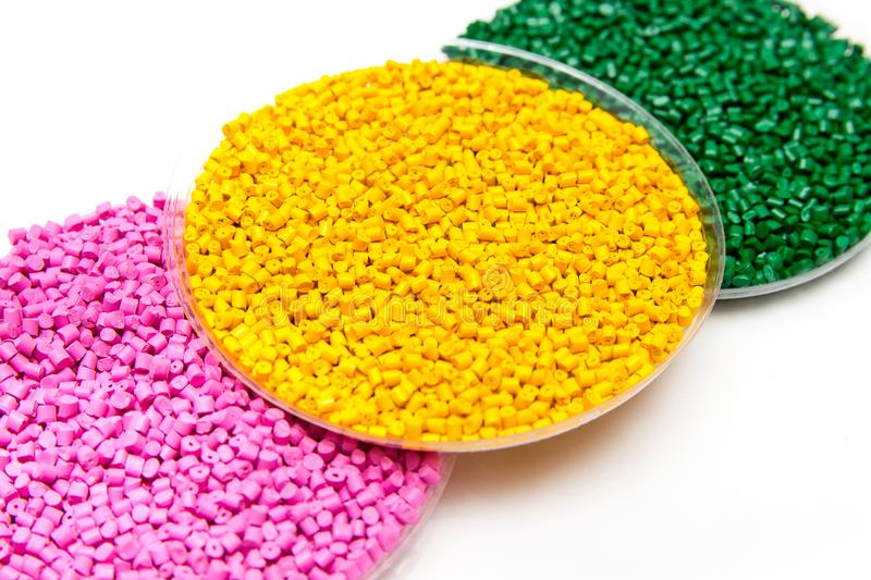 The plastic granules. Dye for polypropylene, polystyrene granules into a measuring container. The plastic granules. Dye for polypropylene, polystyrene granules royalty free stock images