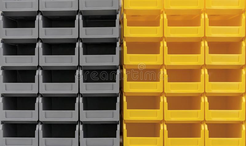 Plastic gray and yellow containers are stacked in several rows.  royalty free stock images