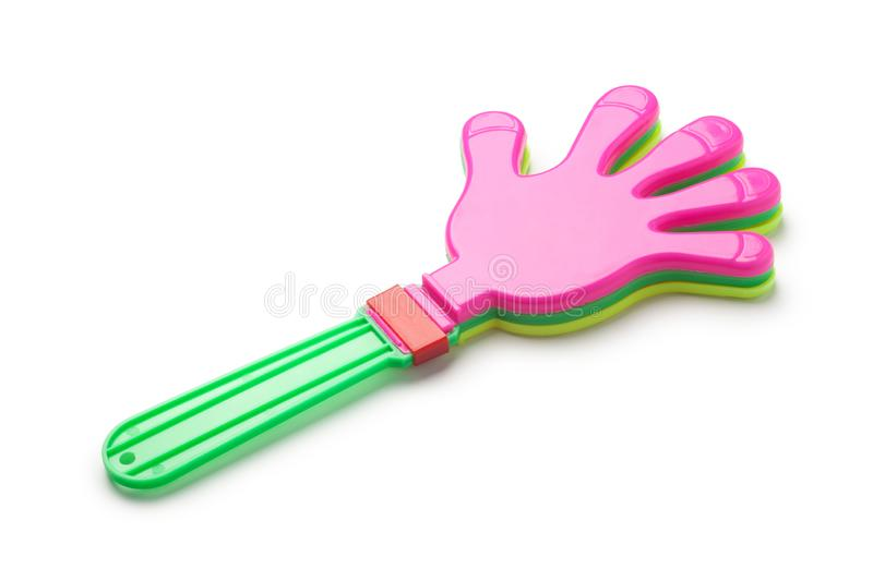 Plastic hand clap toy. Isolated on white background royalty free stock image