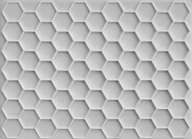 Plastic honingraatachtergrond stock afbeeldingen