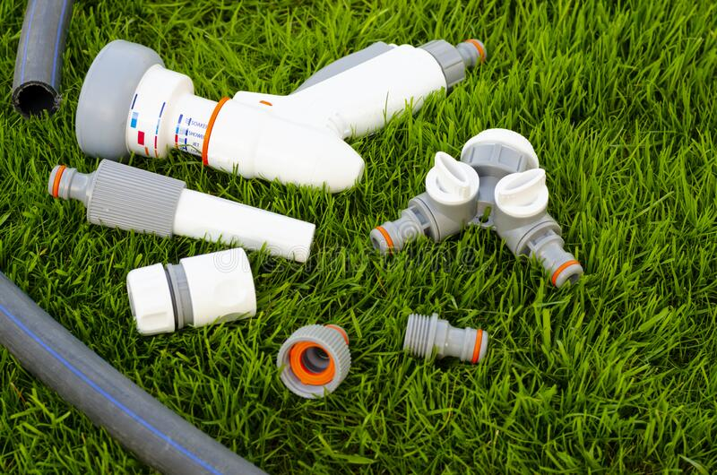 Plastic and hose for automatic watering the garden stock photo