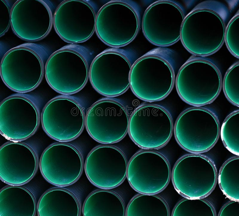 Plastic industrial pipes background stock photo