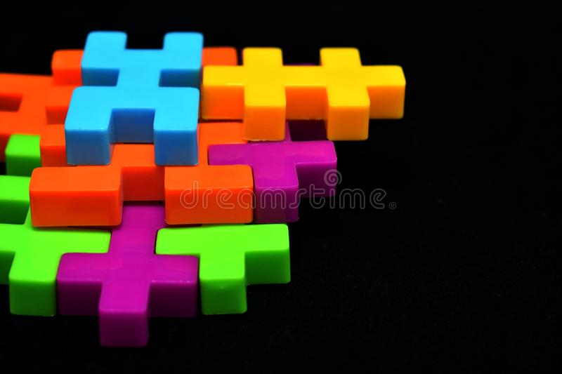 Plastic jigsaw puzzles. Colorful of plastic jigsaw puzzles on black background displayed in bangkok stock photos
