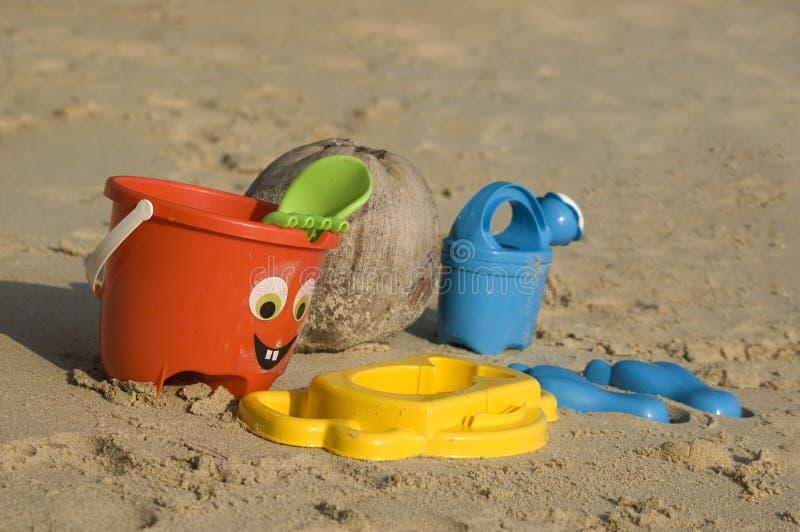 Plastic kids toys on the sand beach. (Koh Samui, Thailand royalty free stock photography